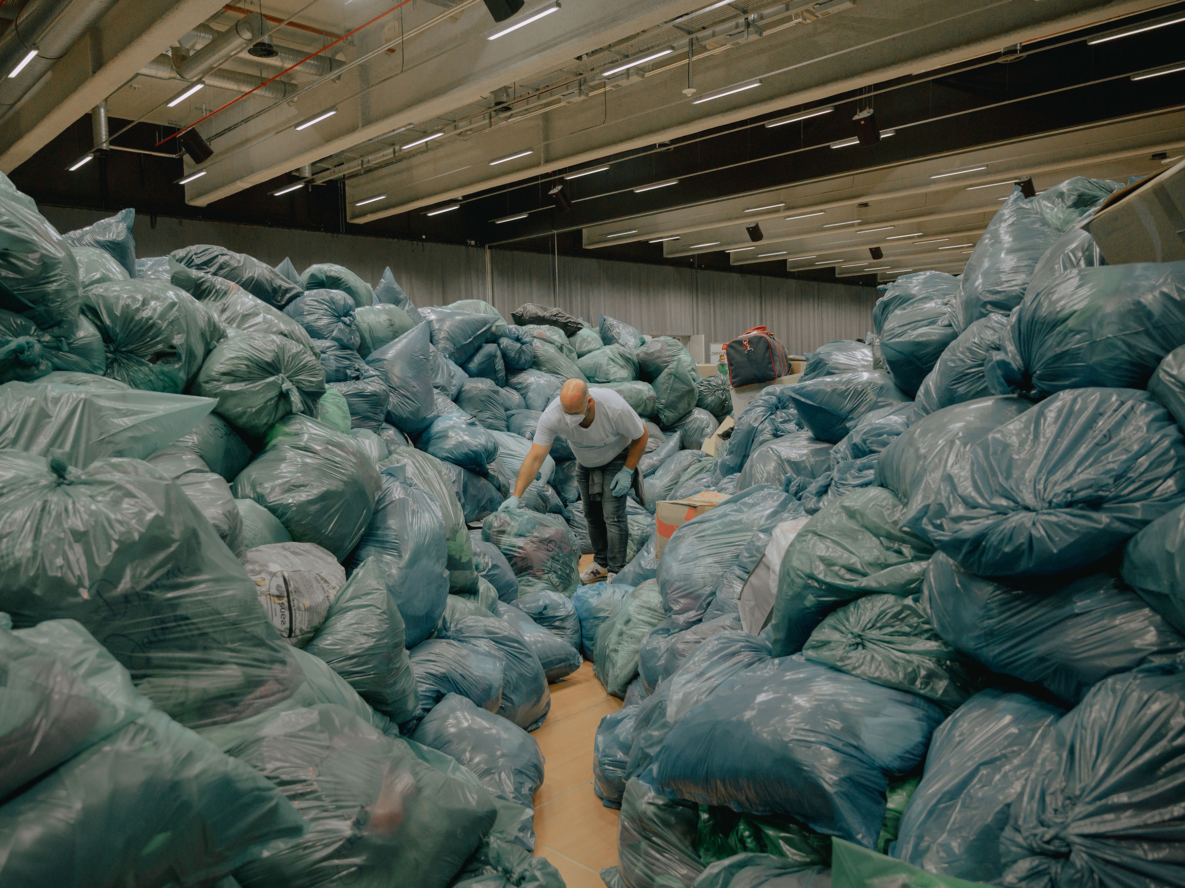 Hundreds of people have volunteered to sort through donations for flood victims at a collection point in Nürburgring, Germany, on July 16.