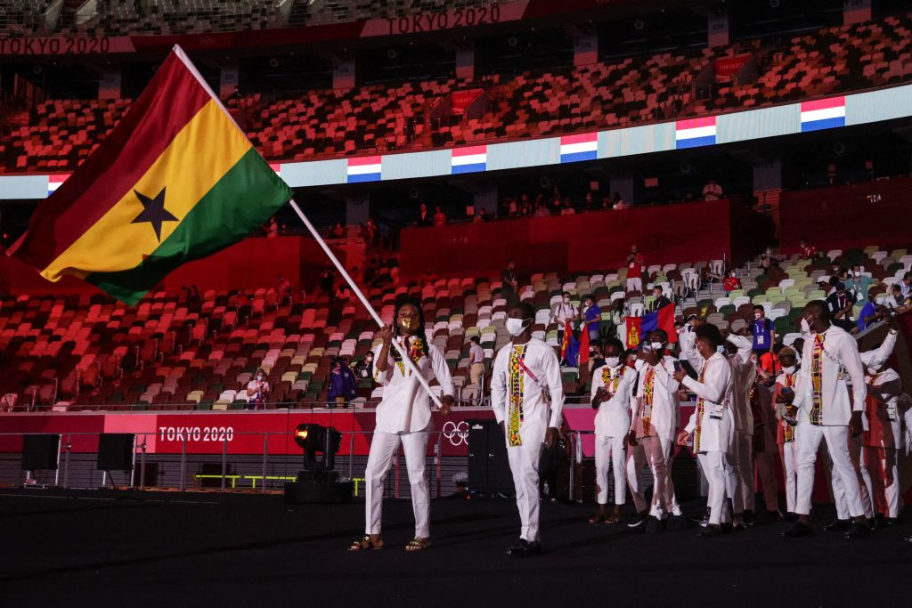 Ghana's flag bearer Nadia Eke leads the delegation during the Tokyo 2020 Olympic Games opening ceremony's parade of athletes, at the Olympic Stadium in Tokyo on July 23, 2021.
