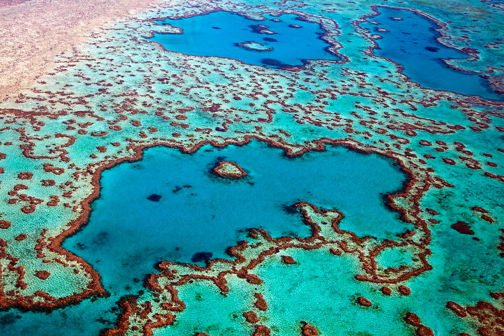 Aerial view of heart-shaped Heart Reef, part of the Great Barrier Reef of the Whitsundays in the Coral sea, Queensland, Australia.