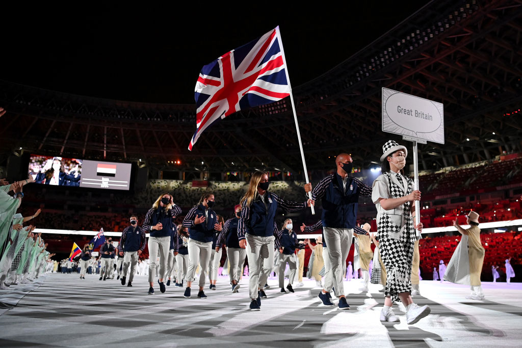 Flag bearers Hannah Mills and Mohamed Sbihi of Team Great Britain leads their team out during the Opening Ceremony of the Tokyo 2020 Olympic Games at Olympic Stadium on July 23, 2021 in Tokyo, Japan.