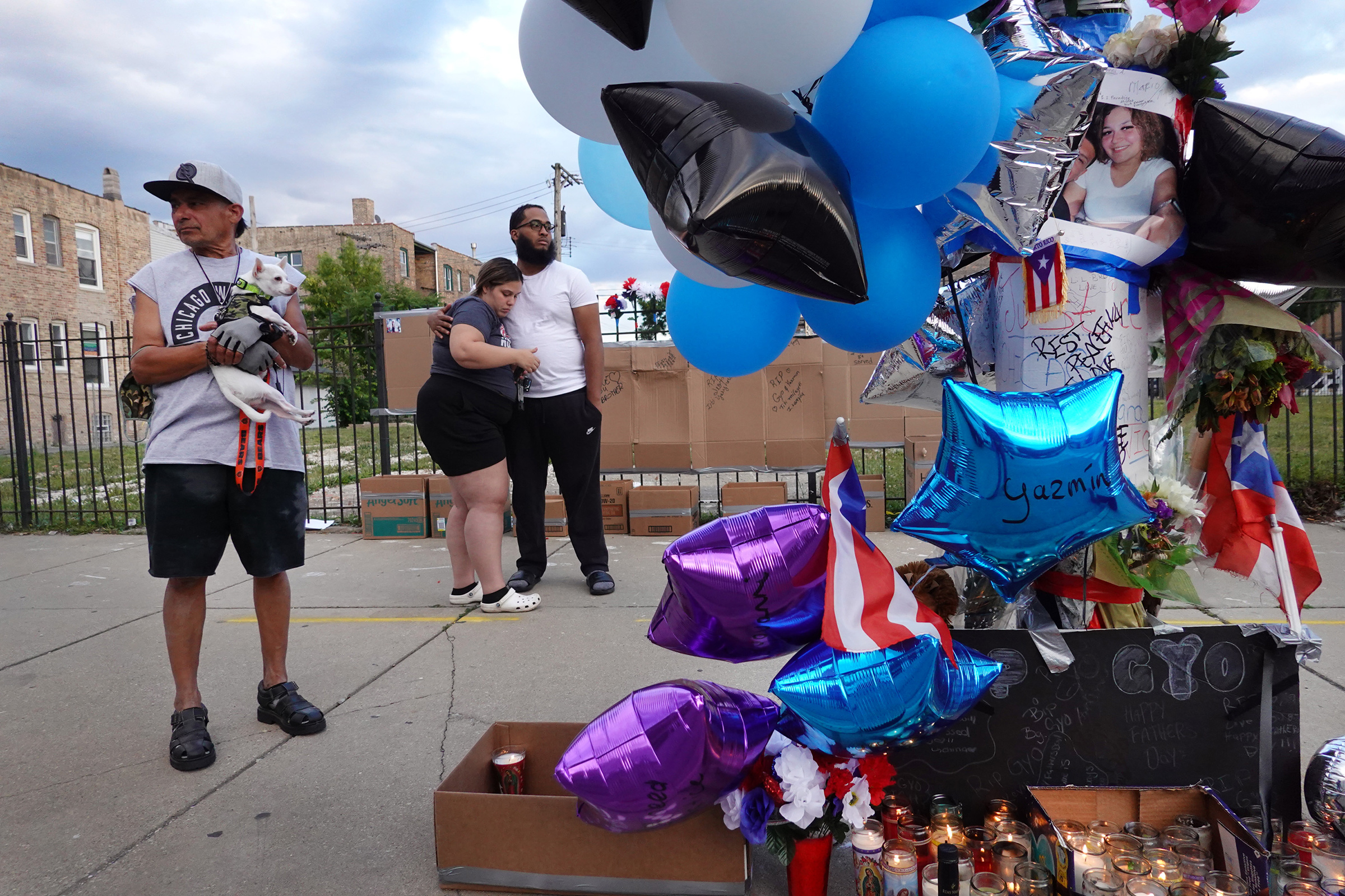 Mourners gather to remember Gyovanni Arzuaga, 24, and Yasmin Perez, 25, at a makeshift memorial at the location where both were shot as they celebrated their Puerto Rican heritage Saturday in the Humboldt Park neighborhood on June 22 in Chicago.