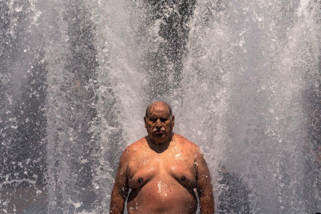 Pablo Miranda cools off in the Salmon Springs Fountain on June 27, 2021 in Portland, Oregon.