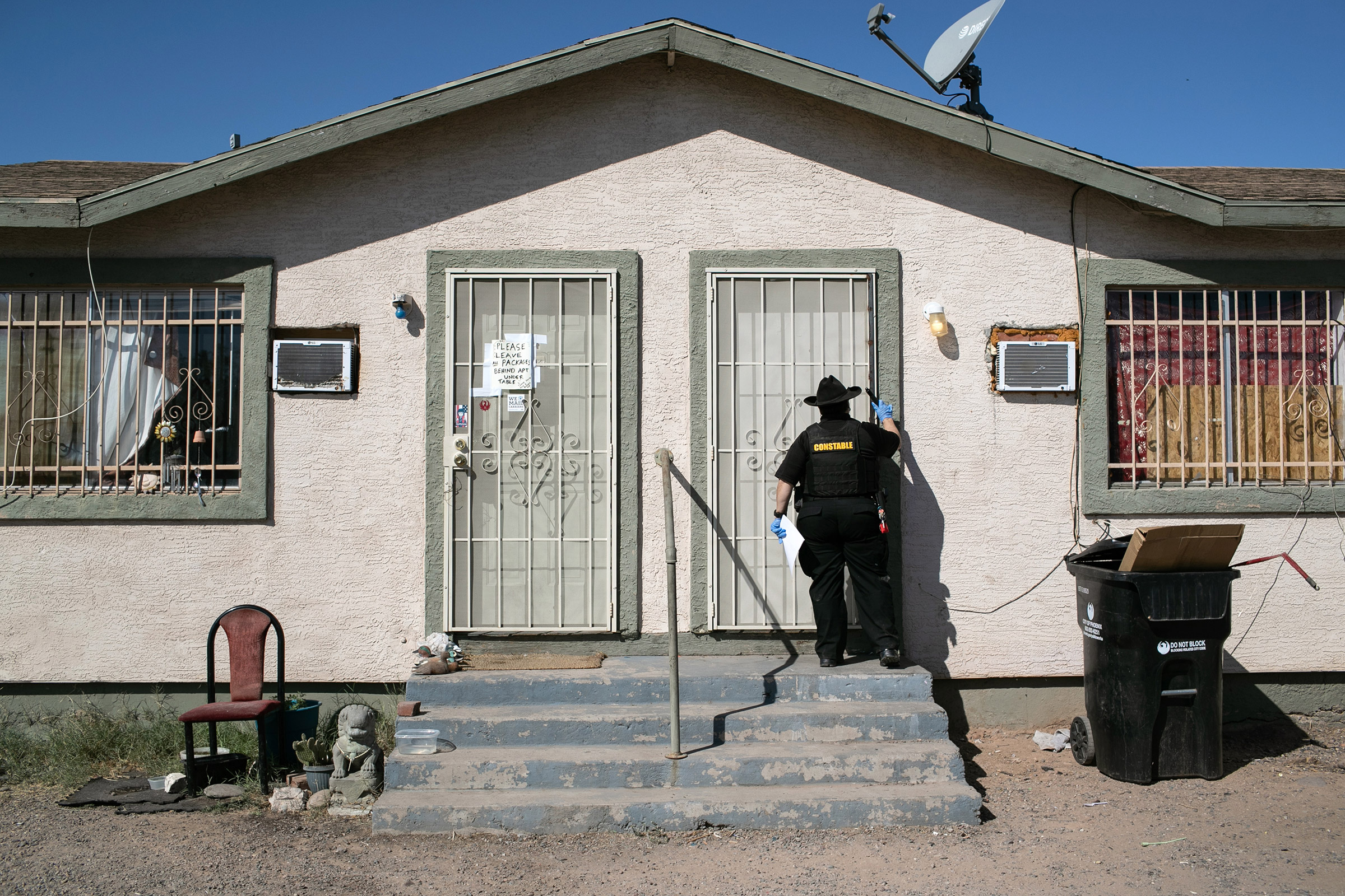 Maricopa County constable Darlene Martinez knocks on a door before posting an eviction order on October 1, 2020 in Phoenix, Az.