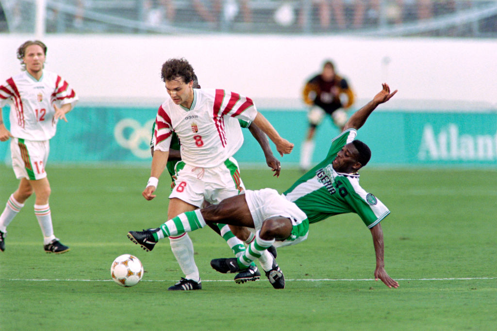 On July 21, 1996, Hungary's Tamas Sandorduring (C, 8) fights for the ball with Nigeria's Azuka Okocha (10) during the first half of their 1996 Summer Olympic match in Orlando.
