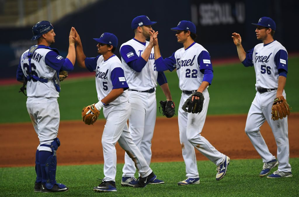 Israel team players celebrate their victory against the Netherlands after their first round game of the World Baseball Classic at Gocheok Sky Dome in Seoul on March 9, 2017.