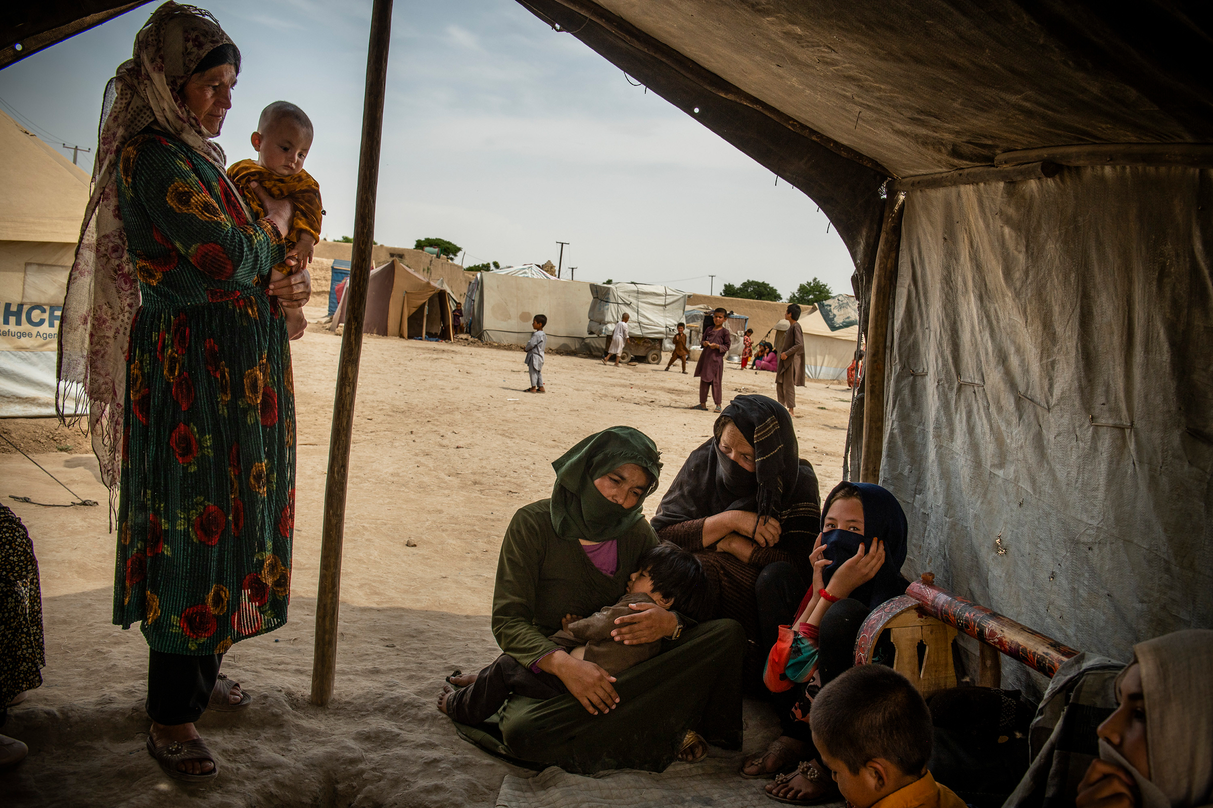 Kowsar 13, and her sister, Madina, 15, in a tent for internally displaced people in Afghanistan's northern Jowzjan Province on May 3, 2021. They have not been able to continue their education because the Taliban took over their home and banned girls like her from going to school.