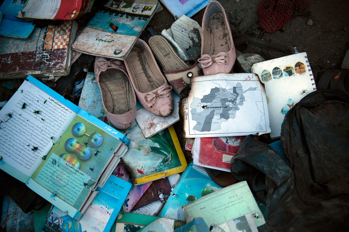 Items recovered outside Sayed Ul-Shuhada high school in Kabul are laid out on May 8, 2021, so families can identify and collect them after a bombing occurred that afternoon.