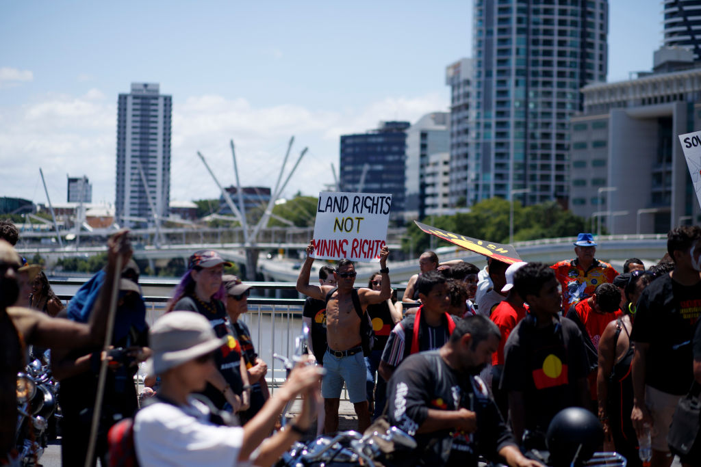 A protester holds a sign dictating against mining rights in Australia during the protest. On the 26th of January, many Australians celebrate Australia day, but to many indigenous Australian people, it is a day synonymous with decades of systematic abuse and genocide. Several thousand protesters took the streets in Brisbane (known as Meanjin by local indigenous people) to rally for sovereignty rights and date changes.