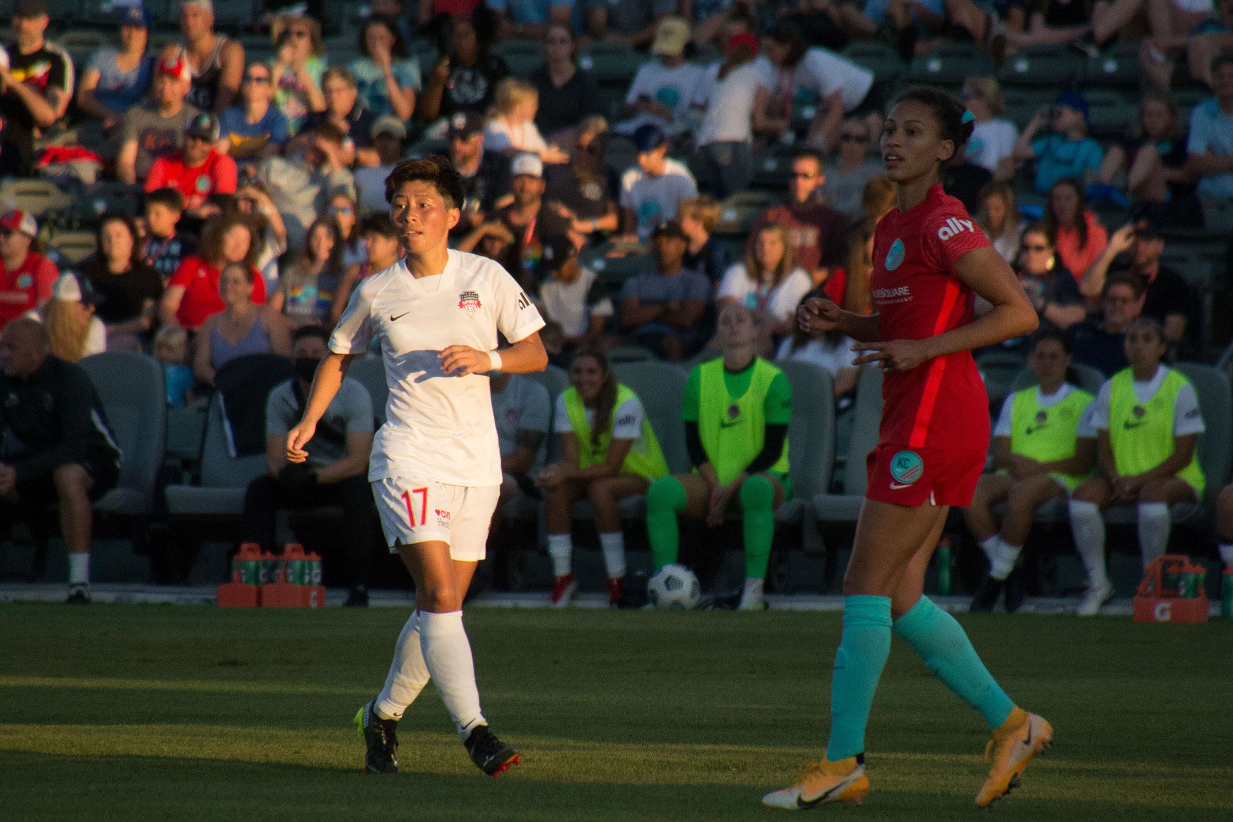 Kumi Yokoyama, left, during the National Women's Soccer League game between Kansas City NWSL and Washington Spirit at Legends Field in Kansas City, Kansas on June 26, 2021.