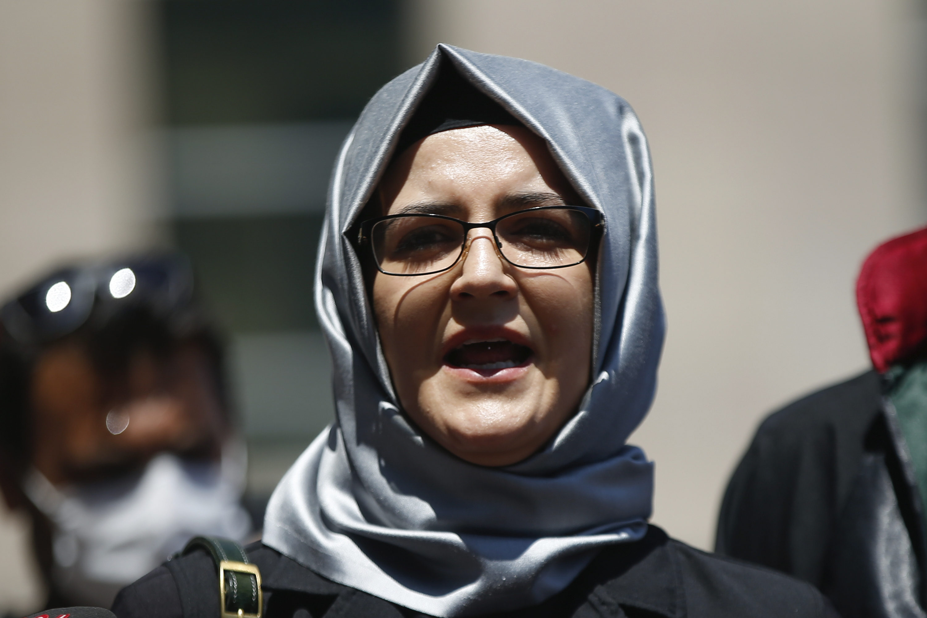 In this July 3, 2020, file photo, Hatice Cengiz, the fiancee of slain Saudi journalist Jamal Khashoggi, talks to members of the media in Istanbul. Amnesty International reported that its forensic researchers had determined that NSO Group's flagship Pegasus spyware was successfully installed on the phone of Cengiz, just four days after Khashoggi was killed.