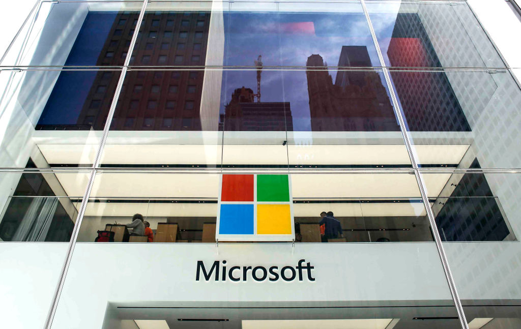 Costumers visit the Microsoft branch on Fifth Avenue in New York City on April 26, 2018 in New York.