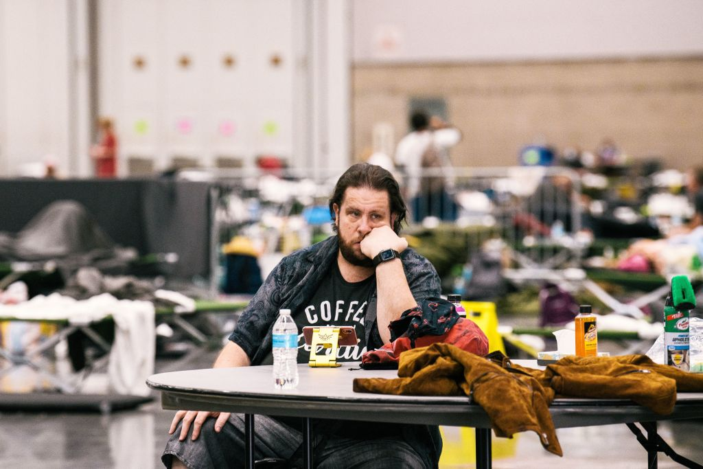 Andrew Steven rests at the Oregon Convention Center cooling station in Oregon, Portland on June 28, 2021, as a heatwave moves over much of the United States.