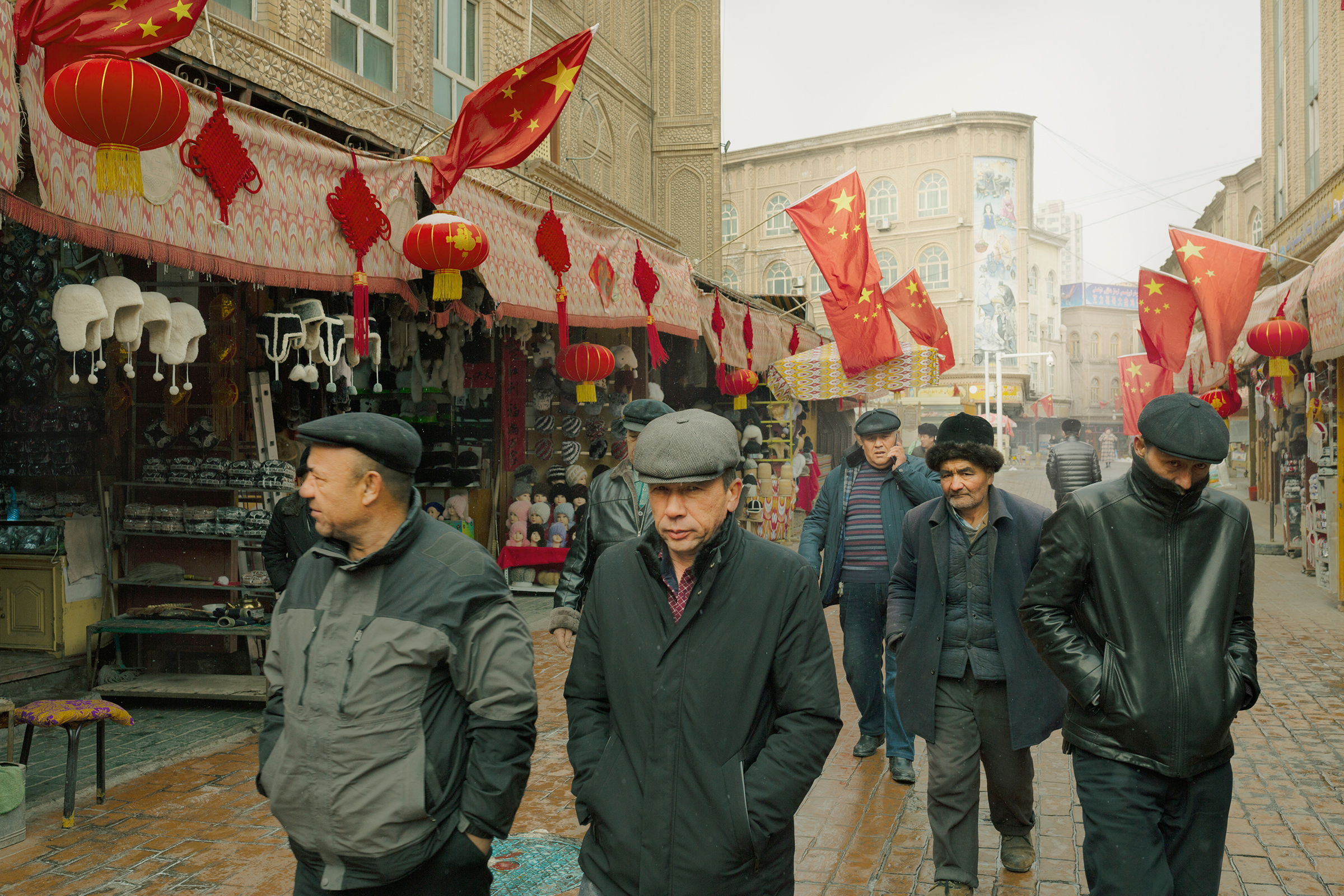 Uighur men strolling through Kashgar, Xinjiang, in January 2019