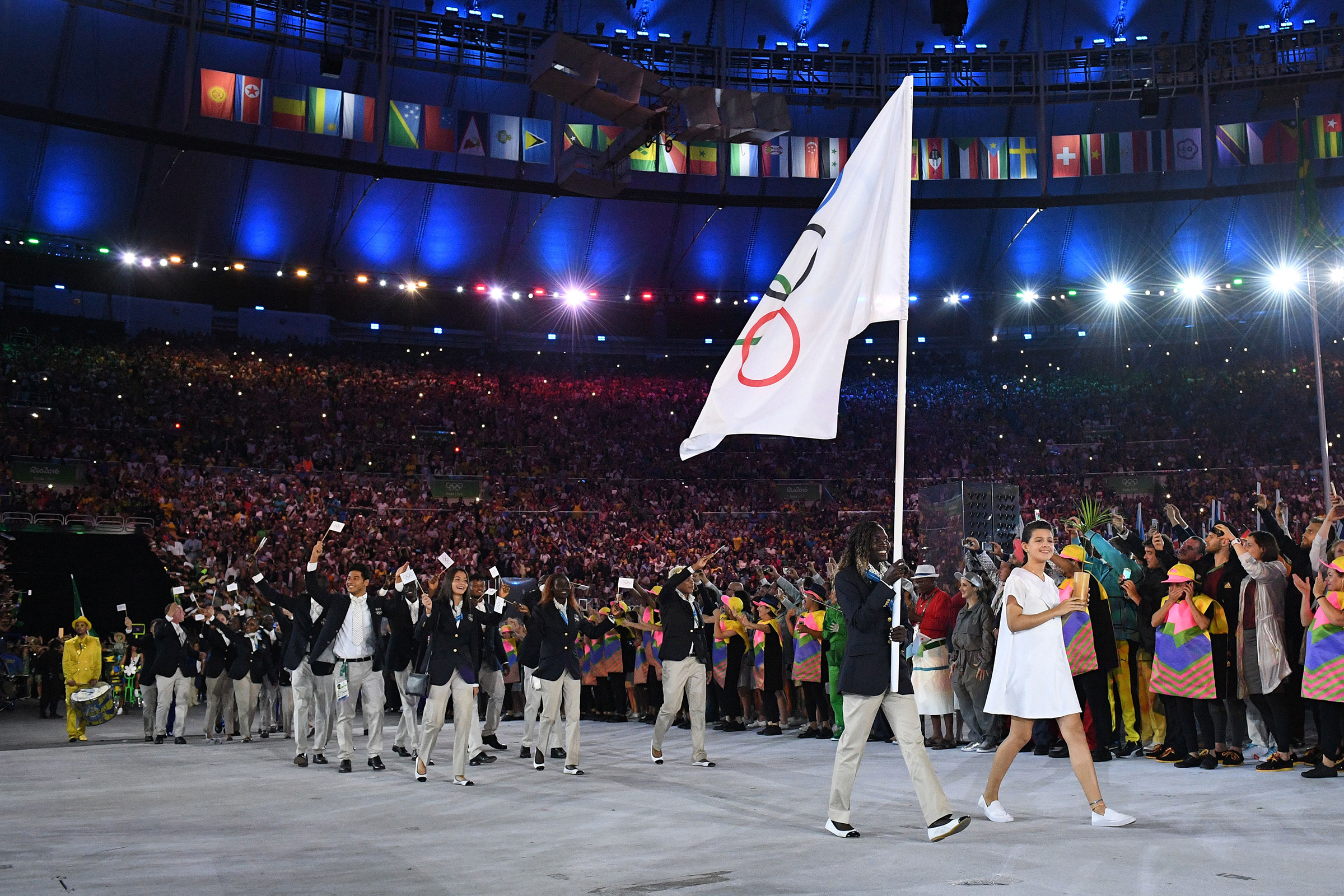 Rose Nathike Lokonyen carries the Olympic flag during the opening ceremony of the Rio 2016 Olympic Games.