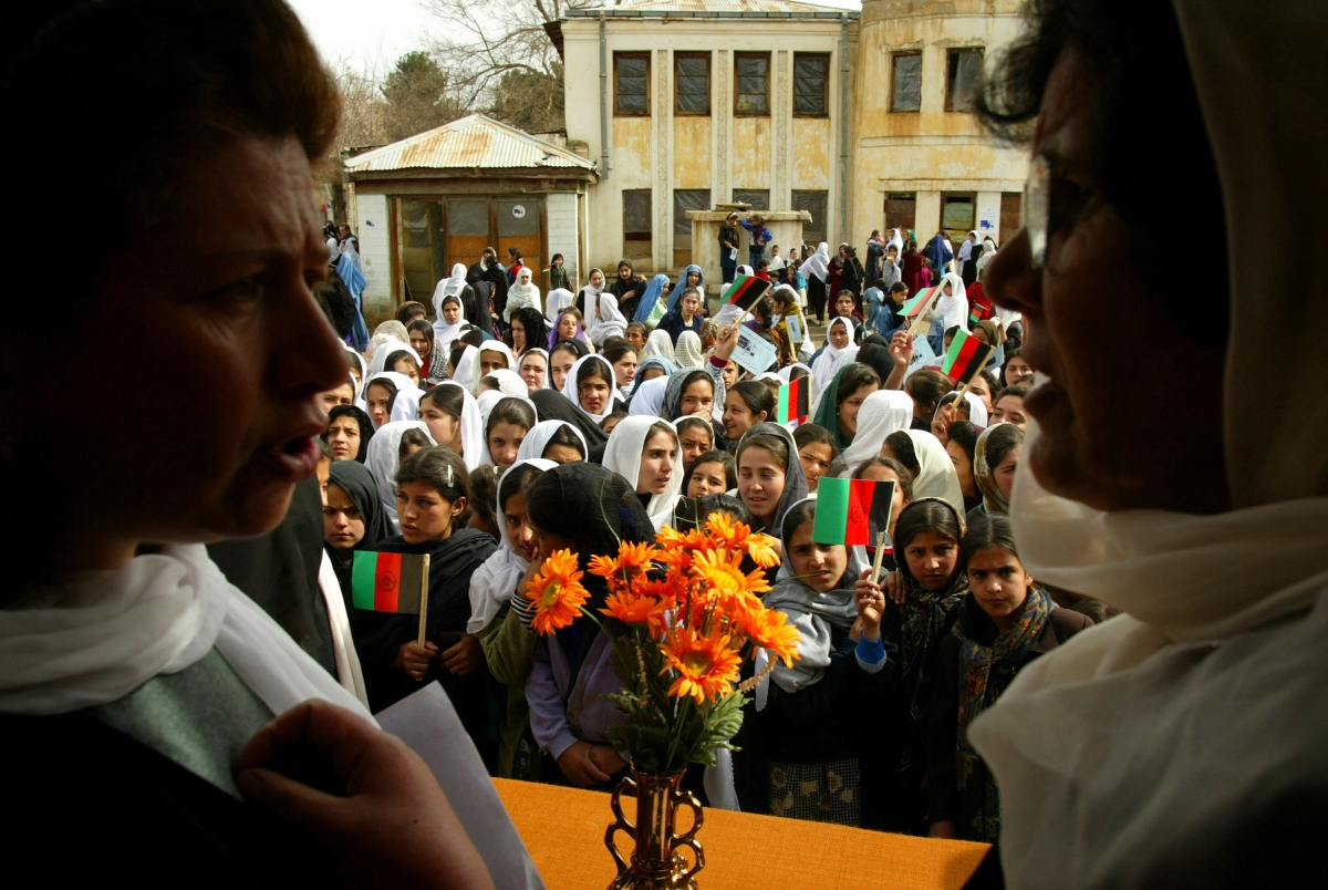 Teachers prepare to organize students into a group for the opening ceremonies on the first day of class at the Manoo Chera school in Kabul on March 23, 2002.