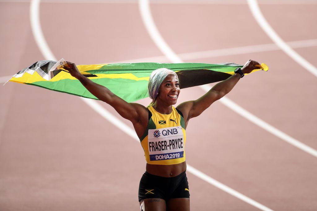 Shelly-Ann Fraser-Pryce of Jamaica celebrates winning the women's 100m final during the IAAF World Athletics Championships 2019 at the Khalifa Stadium in Doha, Qatar, 29 September 2019.