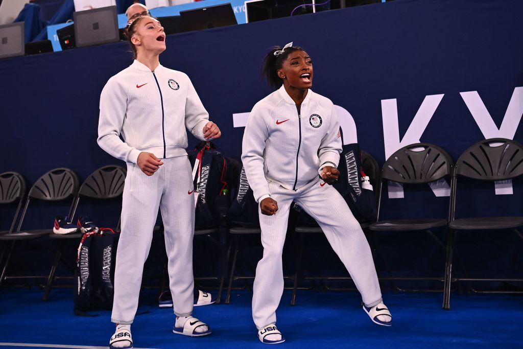 Team USA's Grace Mc Callum and USA's Simone Biles react during the artistic gymnastics women's team final during the Tokyo 2020 Olympic Games at the Ariake Gymnastics Centre in Tokyo on July 27, 2021.