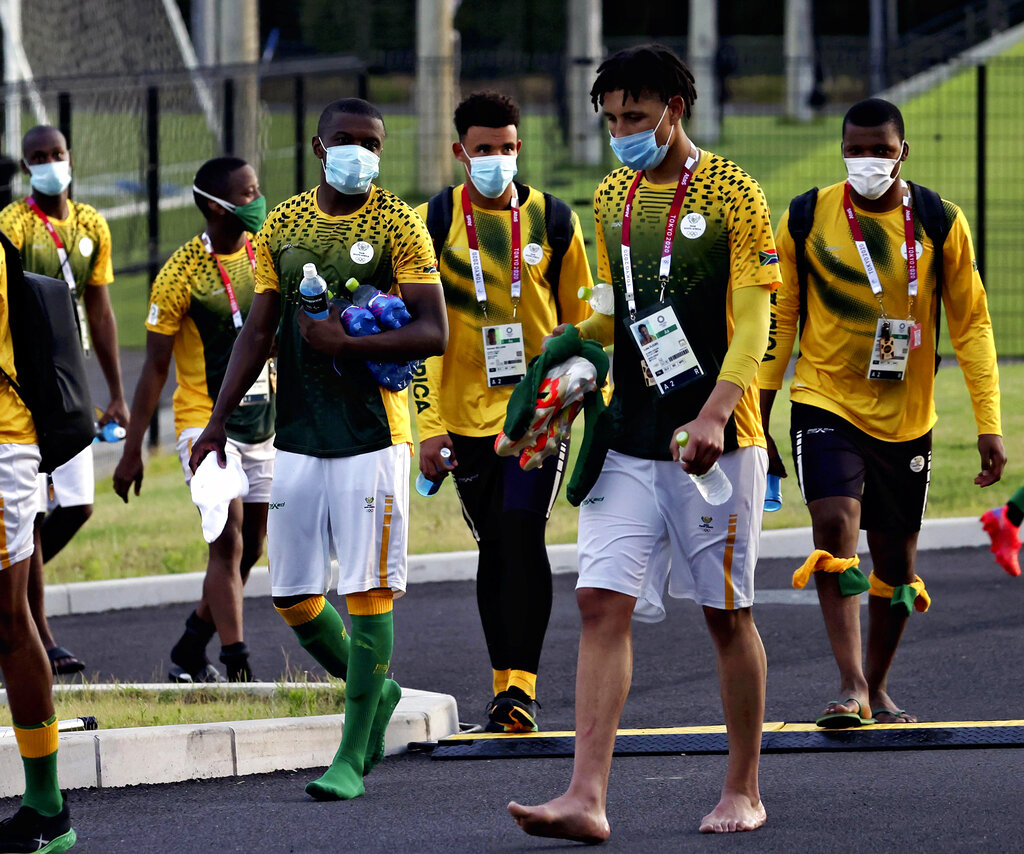 Members of South Africa national soccer team, wearing a face mask, leave the stadium after practicing in Chiba Prefecture, near Tokyo on July 20, 2021. Three team members became the first athletes to test positive for COVID-19 from inside the Olympic Village. South Africa will face Japan squad at Tokyo Stadium on July 22nd.