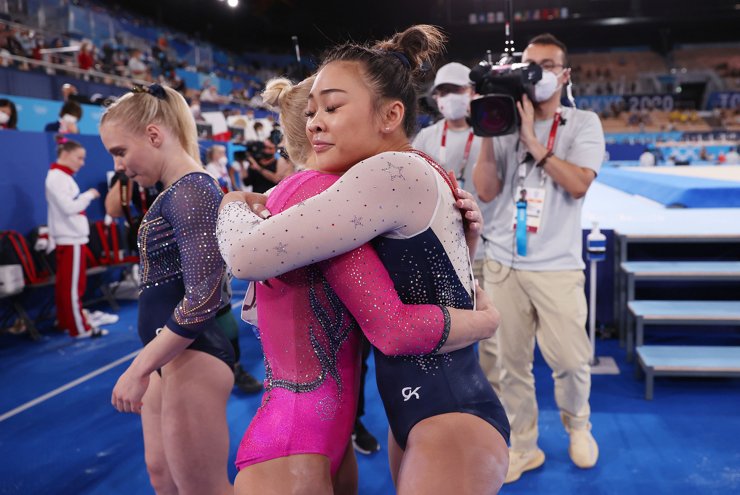 Sunisa Lee of Team United States hugs Angelina Melnikova of Team ROC during the Women's All-Around Final on day six of the Tokyo 2020 Olympic Games at Ariake Gymnastics Centre on July 29, 2021 in Tokyo, Japan.