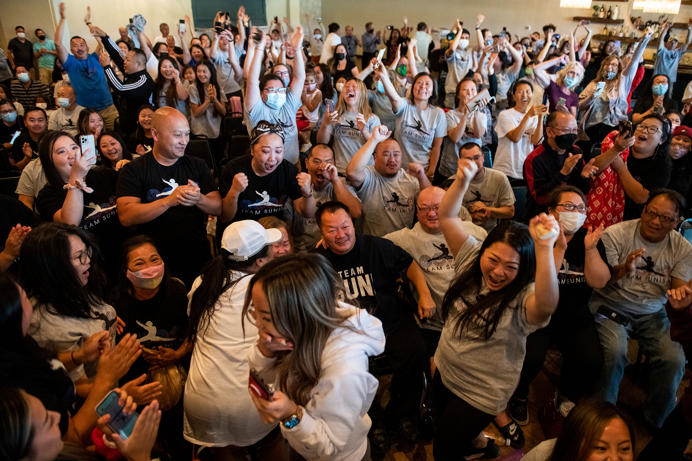 John Lee (C), father of Sunisa Lee of Team United States, celebrates after she won gold in the Women's All-Around Gymnastics Final on day six of the Tokyo 2020 Olympic Games at a watch party on July 29, 2021 in Oakdale, Minnesota.