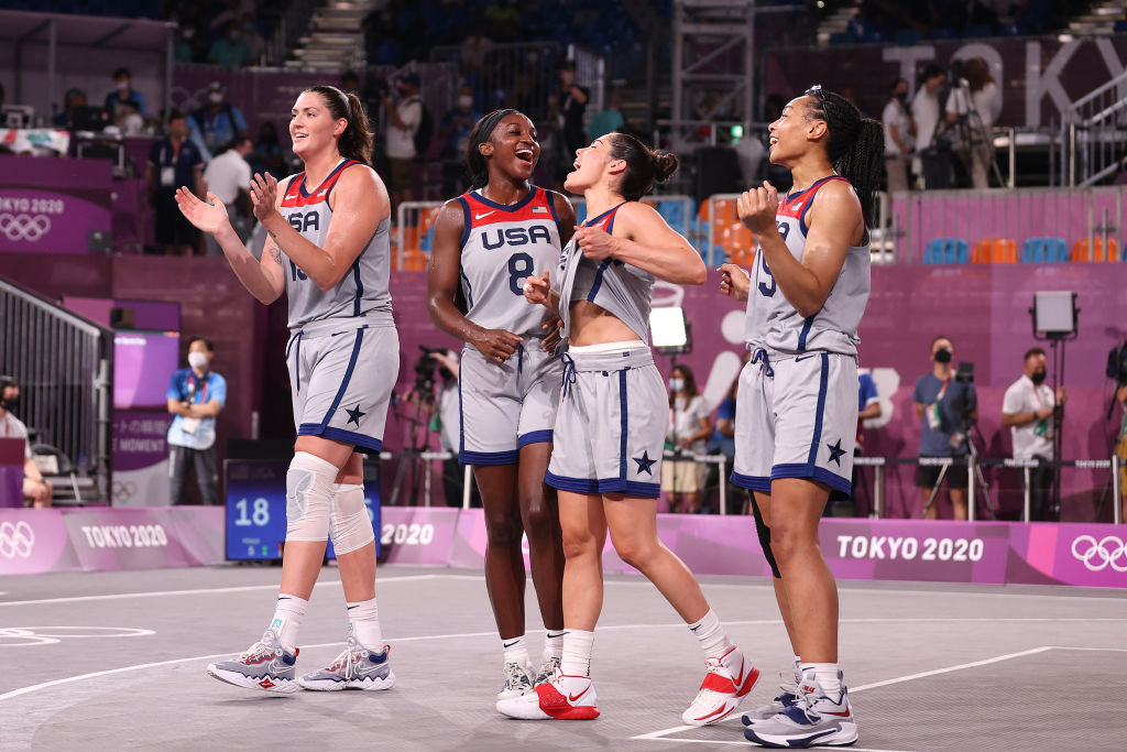 Stefanie Dolson, Jacquelyn Young, Kelsey Plum and Allisha Gray of Team USA celebrate victory and winning the gold medal in the 3x3 Basketball competition at the Tokyo 2020 Olympic Games at Aomi Urban Sports Park on July 28, 2021 in Tokyo, Japan.