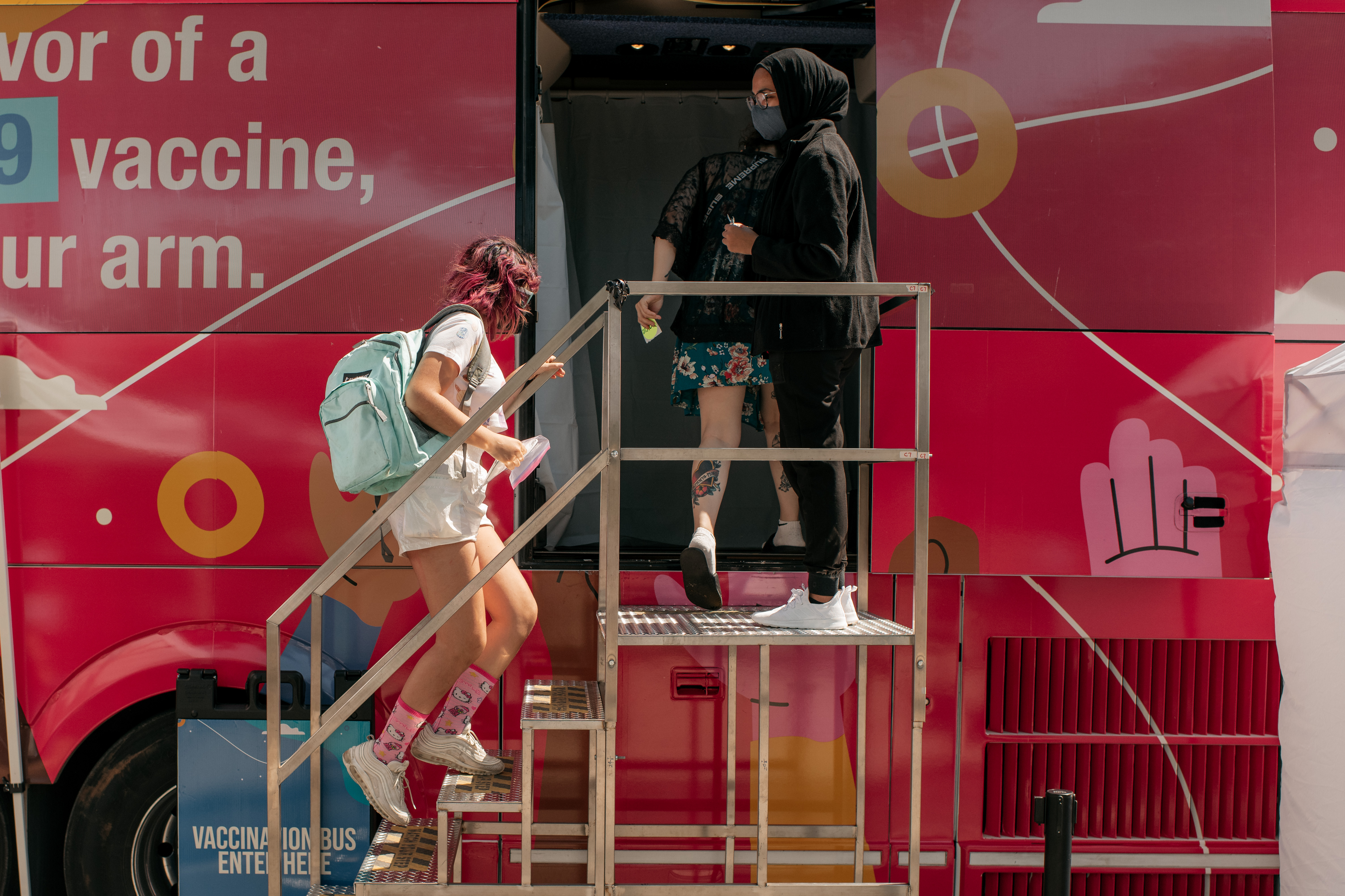 A teenager enters a pop-up COVID-19 vaccine site on June 5, 2021 in the Jackson Heights neighborhood in the Queens borough in New York City.