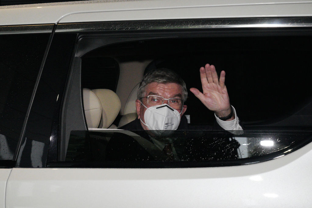 International Olympic Committee president Thomas Bach waves to media as he arrives at an accommodation ahead of the delayed Tokyo Olympic Games in Tokyo, Japan on July 8, 2021.