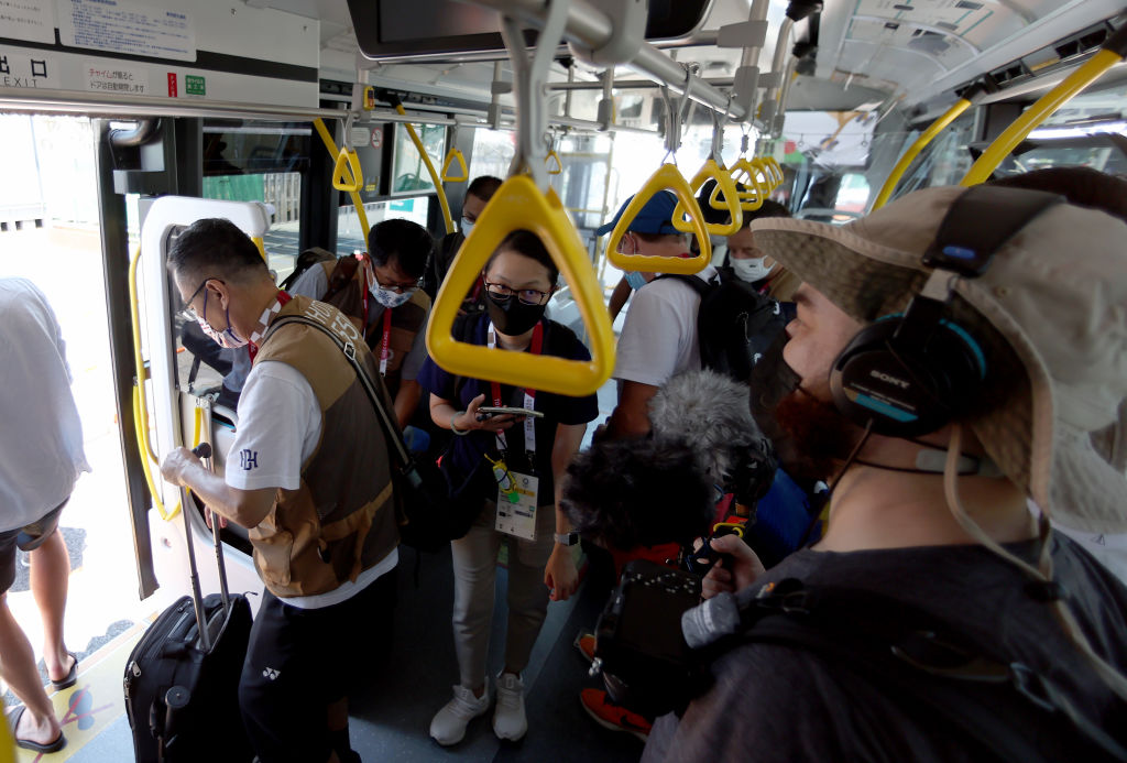 Media members ride the bus from the Main Press Center at Tokyo Big Sight to the transport hub ahead of the Tokyo 2020 Olympic Games on July 22, 2021 in Tokyo, Japan.