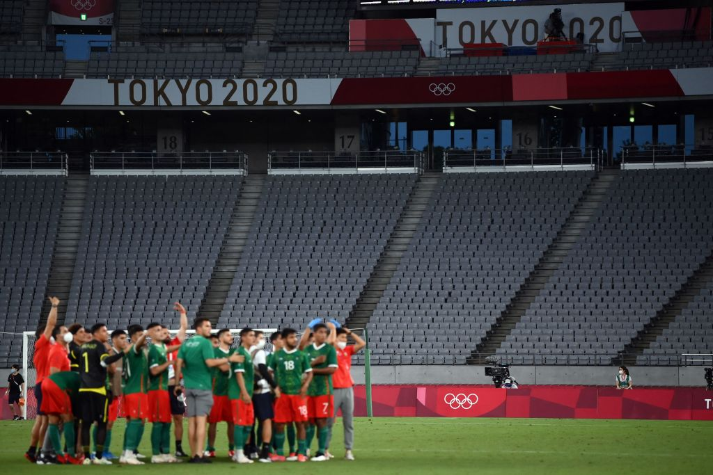 Mexico team celebrate their victory at the end of the Tokyo 2020 Olympic Games men's group A first round football match between Mexico and France at Tokyo Stadium in Tokyo on July 22, 2021.