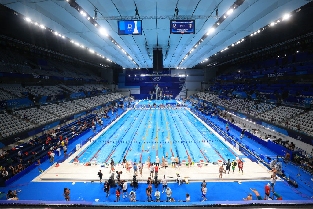 Athletes practice for swimming events at the Olympic Aquatics Centre as part of the 2020 Summer Olympic Games.