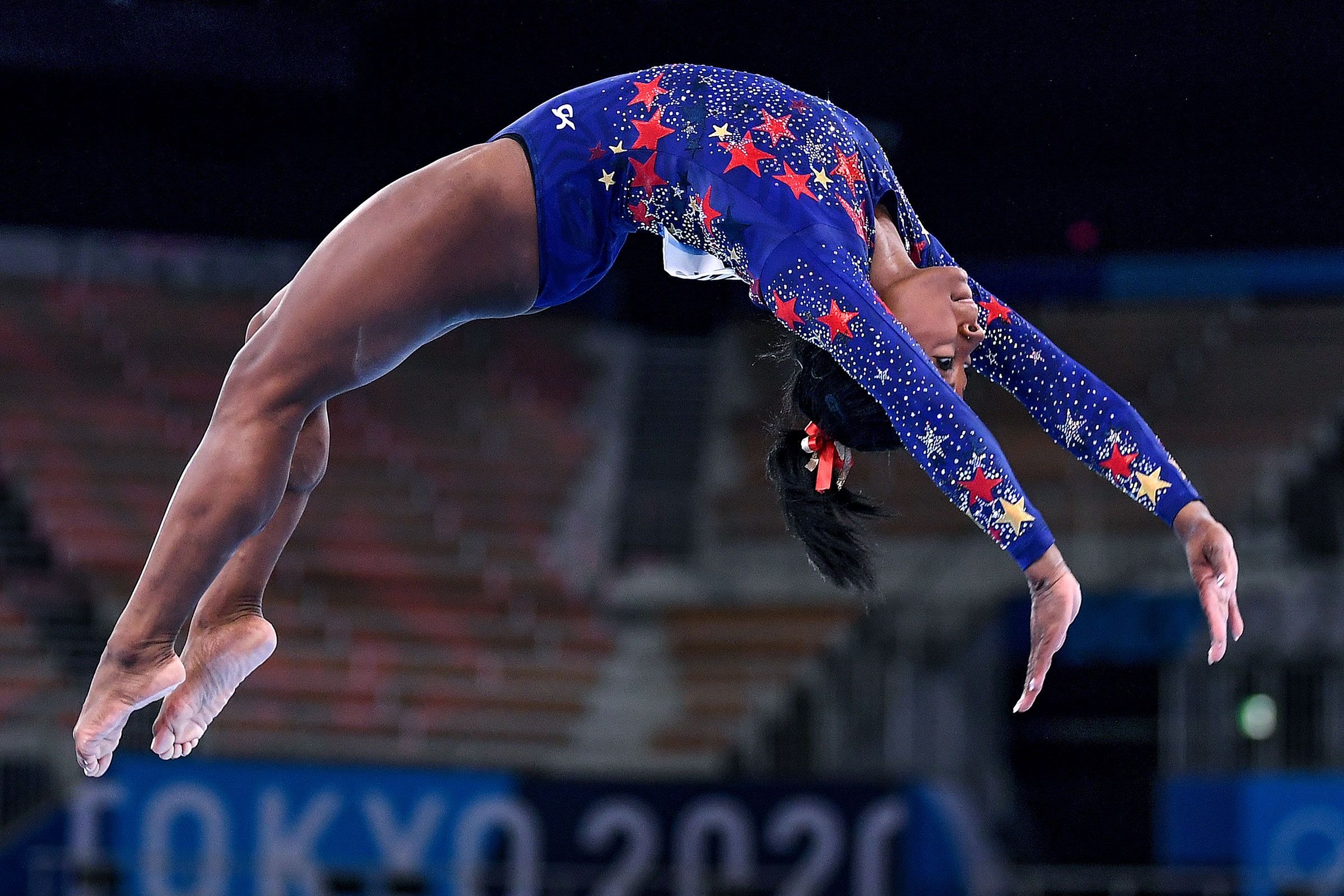 Simone Biles competes on the beam in the women's team qualifying on July 25.