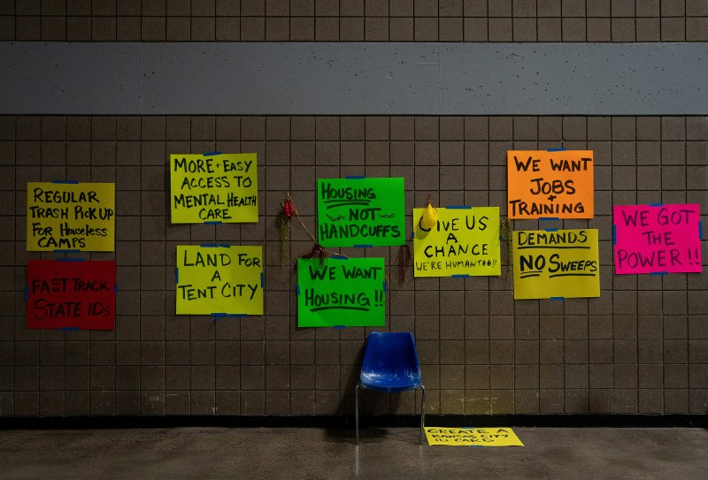 Signs at a temporary center for homeless people run by Kansas City, Mo., on Feb. 11. Cities and community groups are wrestling with how to shelter a vulnerable population without exposing it to an airborne virus that spreads most easily indoors.