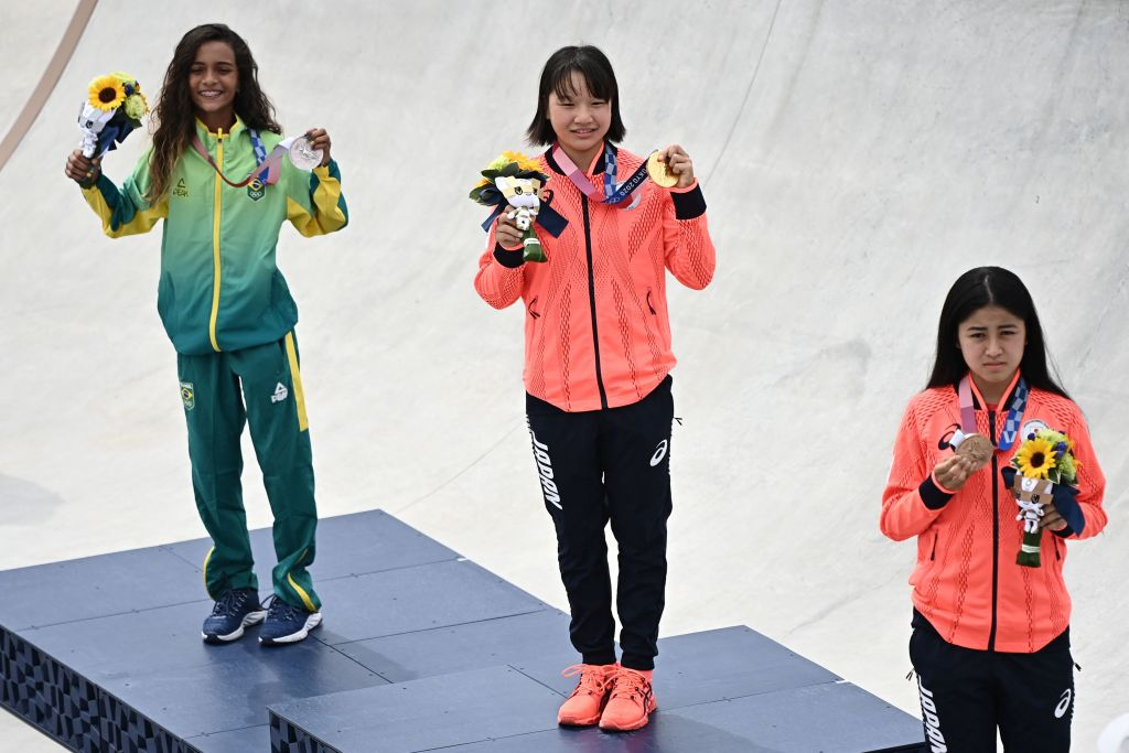 (Left to right) Brazil's Rayssa Leal (silver), Japan's Momiji Nishiya (gold) and Japan's Funa Nakayama (bronze) pose during the medal ceremony of the podium ceremony of the skateboarding women's street final of the Tokyo 2020 Olympic Games at Ariake Sports Park in Tokyo on July 26, 2021.
