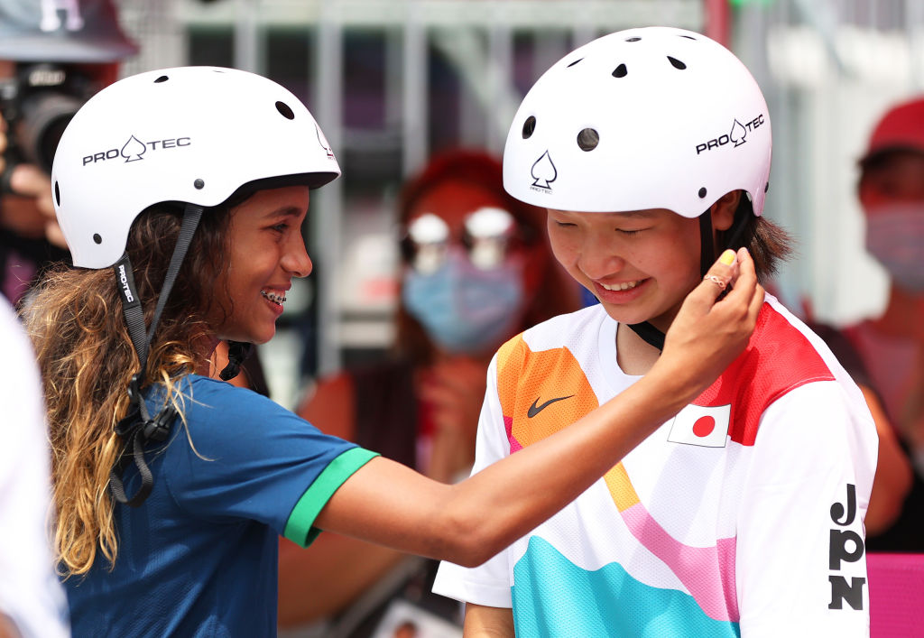 Rayssa Leal puts her hand up to the face of Momiji Nishiya during the Women's Street Final at the Tokyo 2020 Olympic Games on July 26.