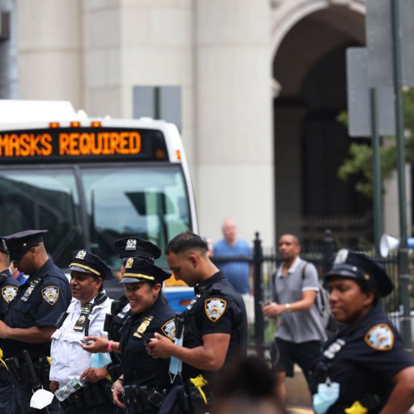 NYPD officers stand watch as people gather at City Hall to protest vaccine mandates on Aug. 09, 2021 in New York City.