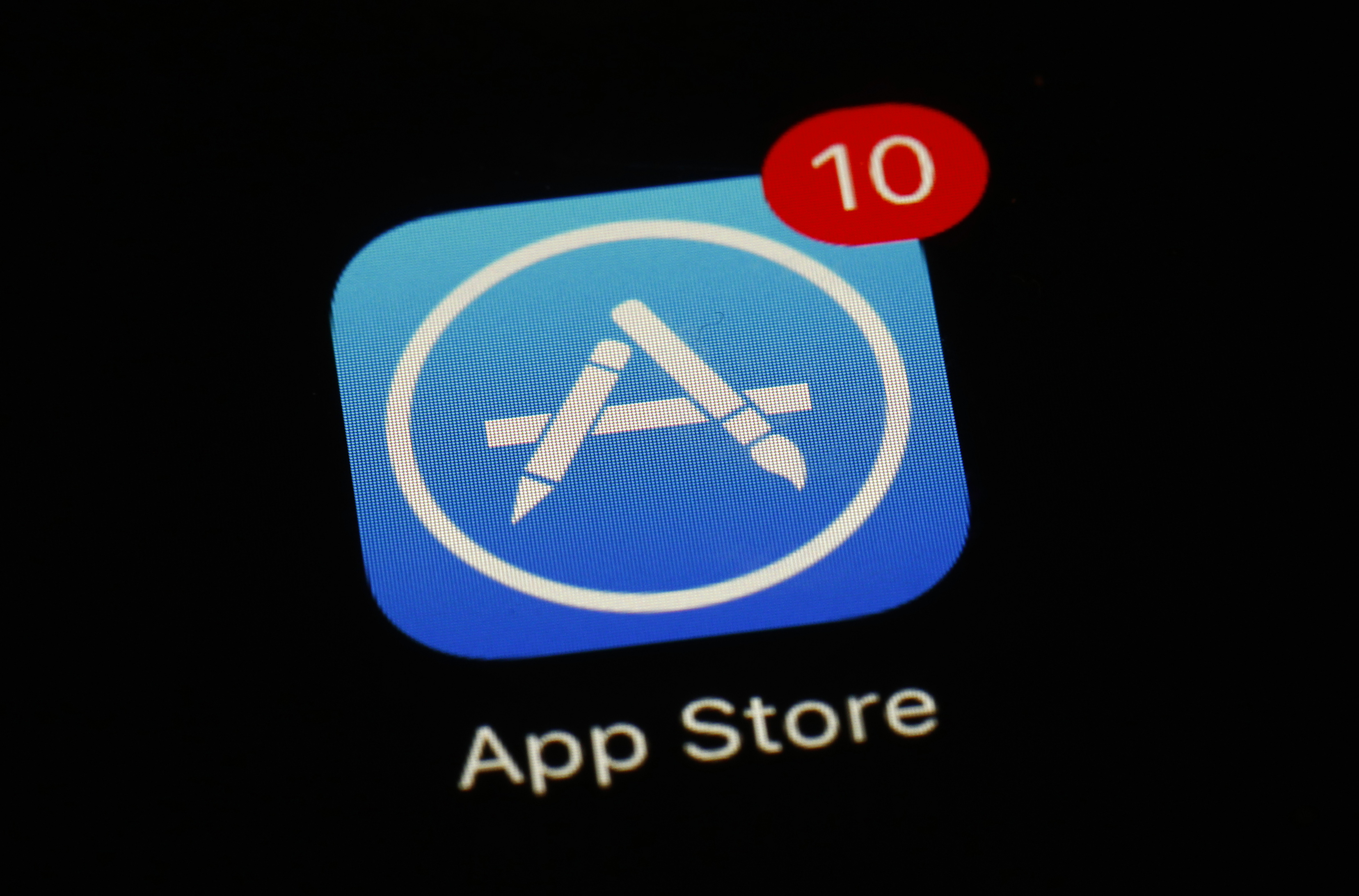 This March 19, 2018, file photo shows Apple's App Store logo on a screen in Baltimore.