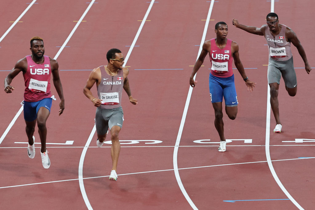 Canada's Andre De Grasse (2nd L) wins the men's 200m final next to USA's Kenneth Bednarek (L), USA's Erriyon Knighton (2nd R) and Canada's Aaron Brown (R) during the Tokyo 2020 Olympic Games at the Olympic Stadium in Tokyo on August 4, 2021.