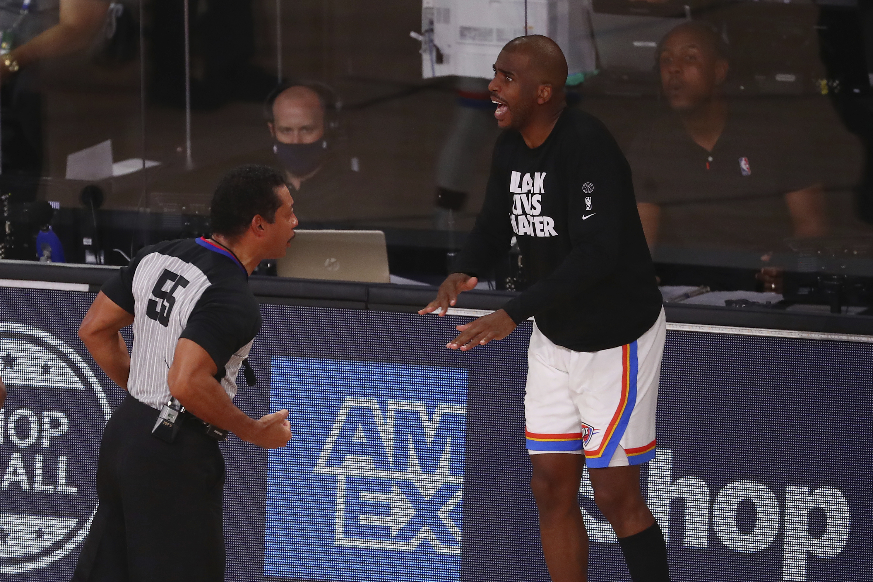 Oklahoma City Thunder guard Chris Paul, right, during Game 4 of the NBA's first-round playoff series on Aug. 24, 2020, in Lake Buena Vista, Fla. NBA players went on strike to protest the police shooting of Jacob Blake two days later on Aug. 26.