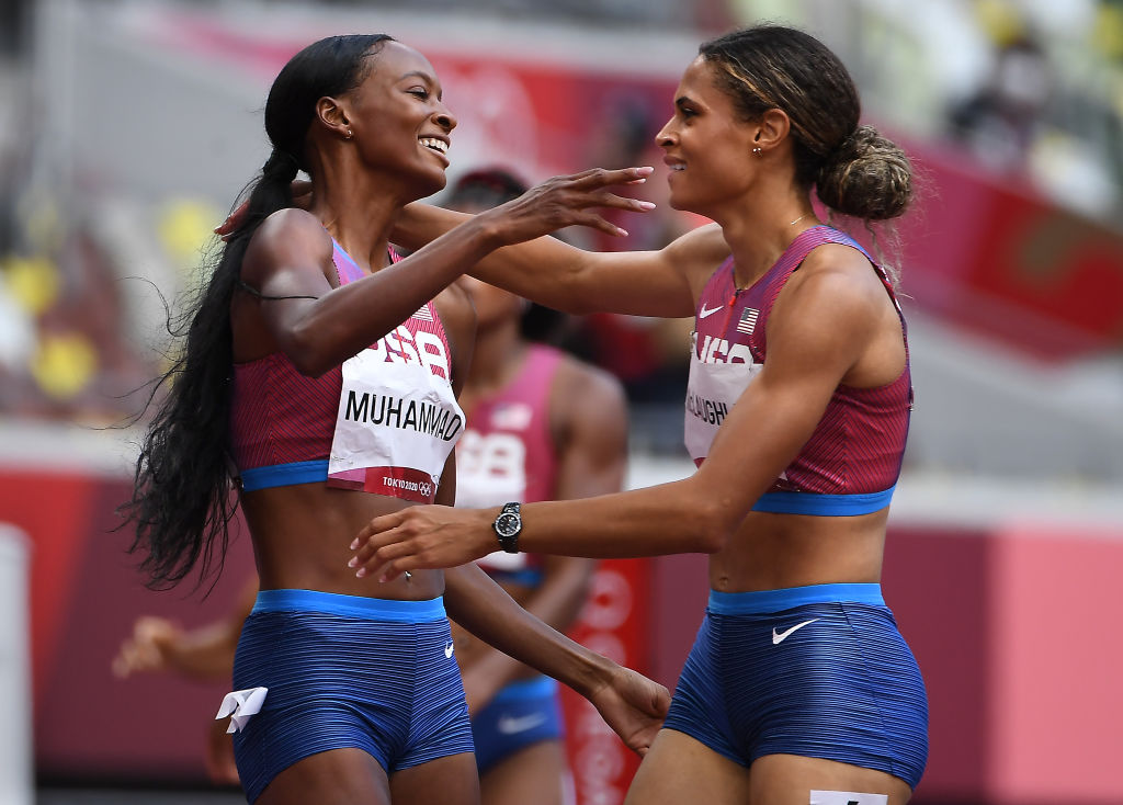 American Sydney McLaughlin, right, celebrates her gold medal with silver medalist and teammate Dalilah Muhammed after the 400m hurdles at the 2020 Tokyo Olympics.