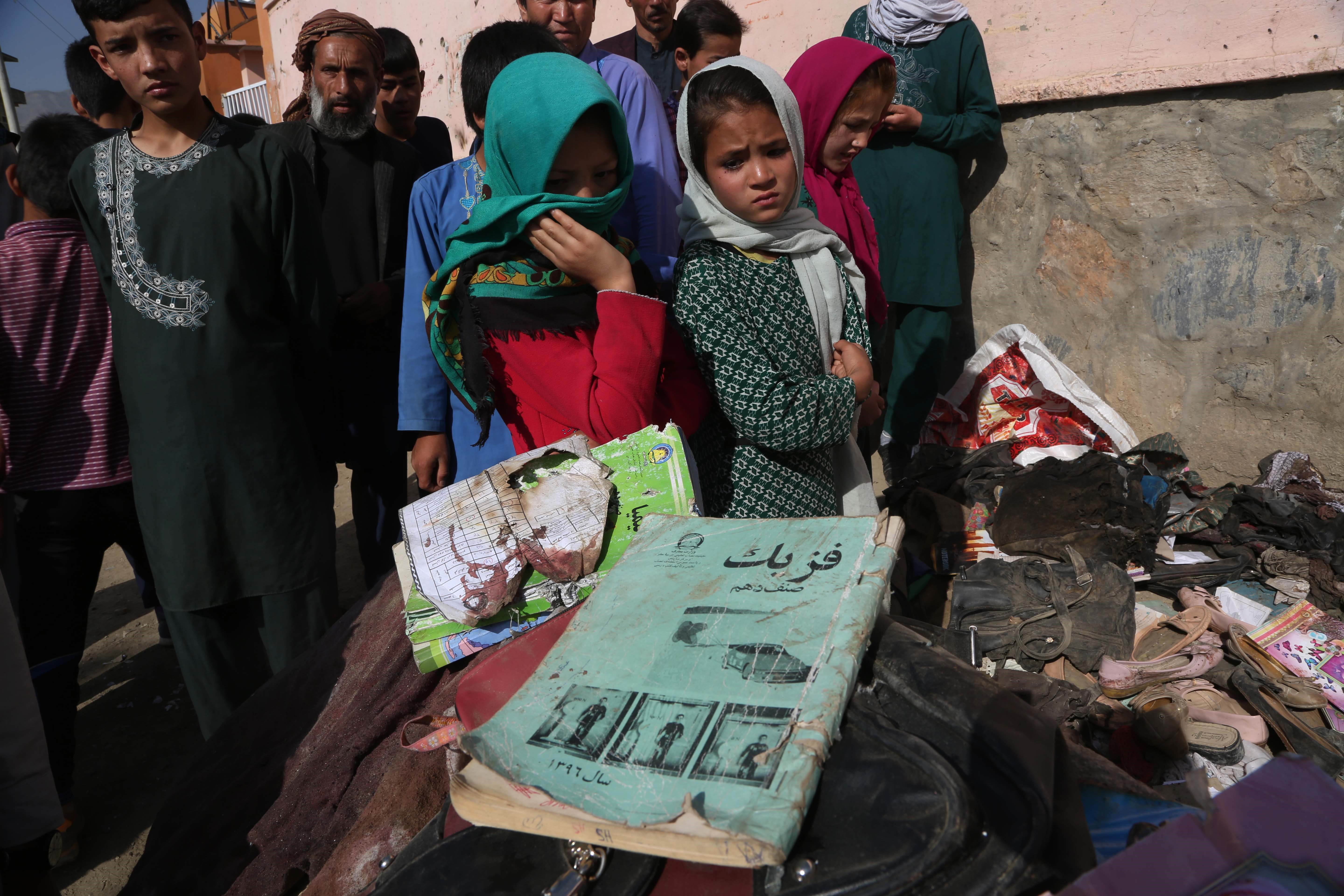 Books of students who were killed in a terror attack in Kabul on May 8, 2021. Most of the victims were school girls while many passers-by were also affected. Getty Images/Xinhua News Agency.