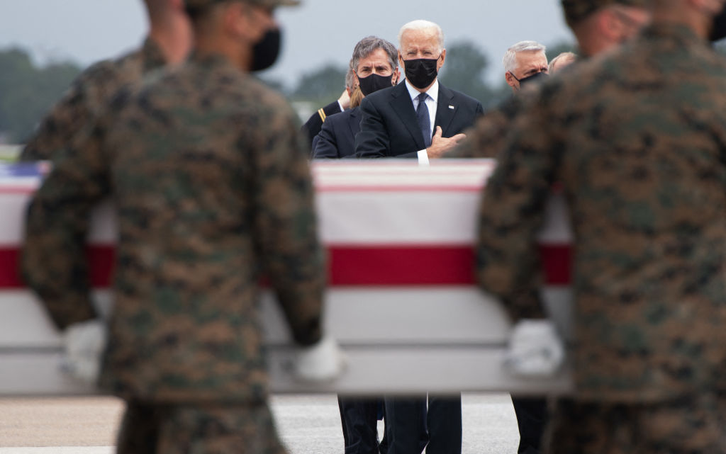 President Joe Biden attends the dignified transfer of the remains of fallen service members at Dover Air Force Base in Dover, Delaware, August, 29, 2021, after 13 members of the US military were killed in Afghanistan.