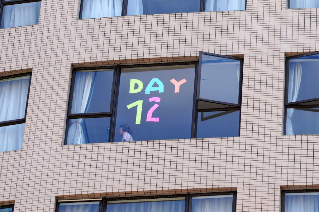 'Day 12' stickers are displayed on the window of Dorsett Wanchai Hong Kong Hotel to record quarantine days on August 17, 2021 in Hong Kong, China.