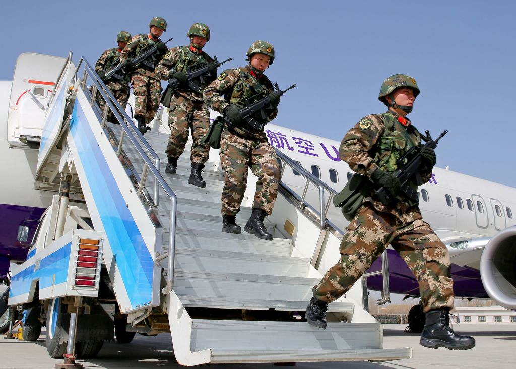 This photo taken on February 27, 2017 shows Chinese military police getting off a plane to attend an anti-terrorist oath-taking rally in Hetian, northwest China's Xinjiang Uighur Autonomous Region.