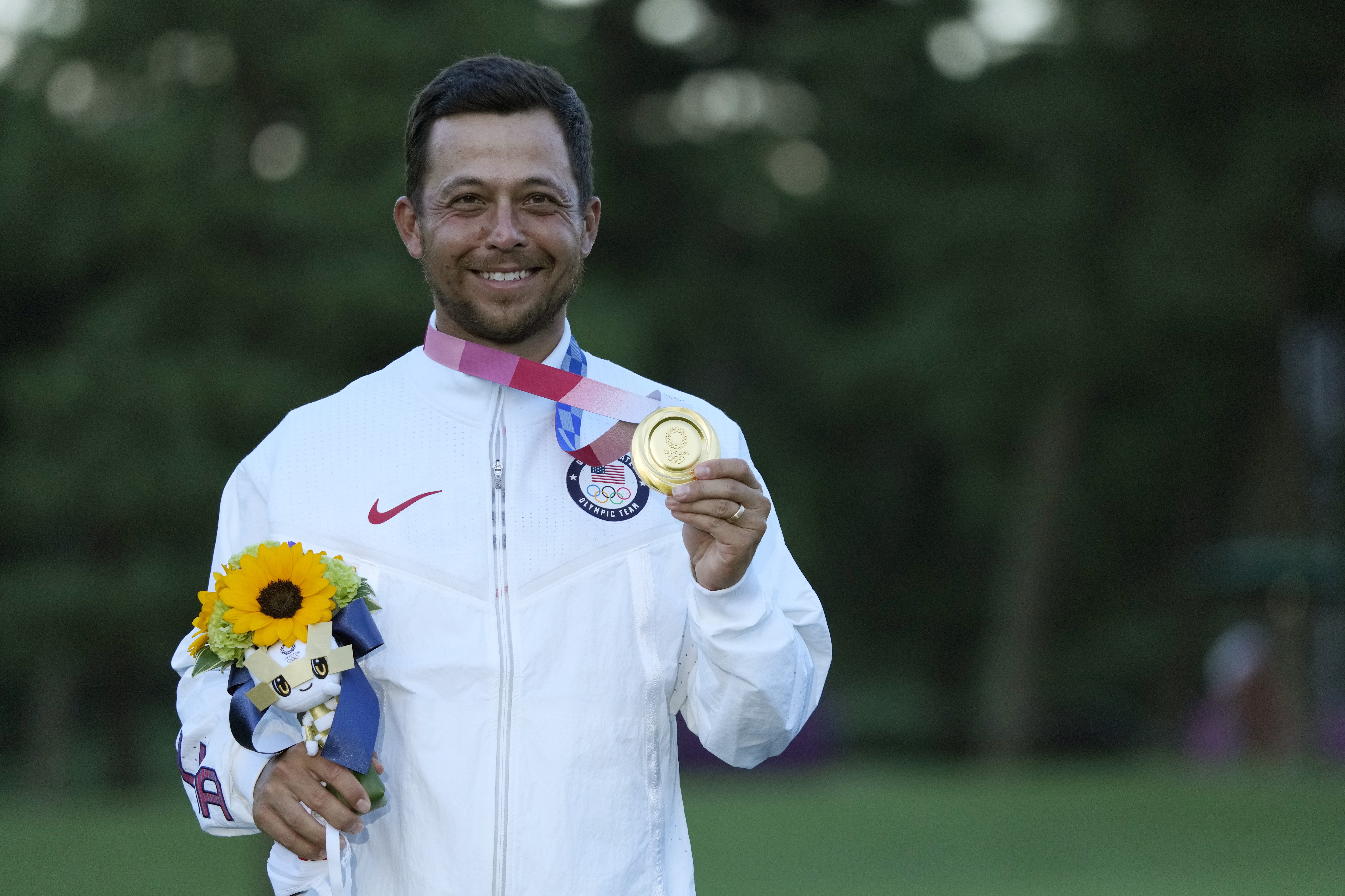 Xander Schauffele, of the United States, holds his gold medal in the men's golf at the 2020 Summer Olympics on in Kawagoe, Japan, on Aug. 1, 2021.