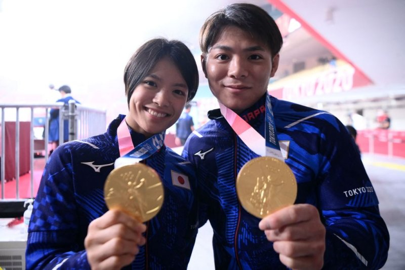 Japan's Hifumi Abe, the gold medallist of the judo men's -66kg contest of the Tokyo 2020 Olympic Games, and his sister Uta Abe, the gold medallist of the judo women's -52kg contest of the Tokyo 2020 Olympic Games, pose with their medals before the final block of the day three of judo competition during the Tokyo 2020 Olympic Games at the Nippon Budokan in Tokyo on July 26, 2021.