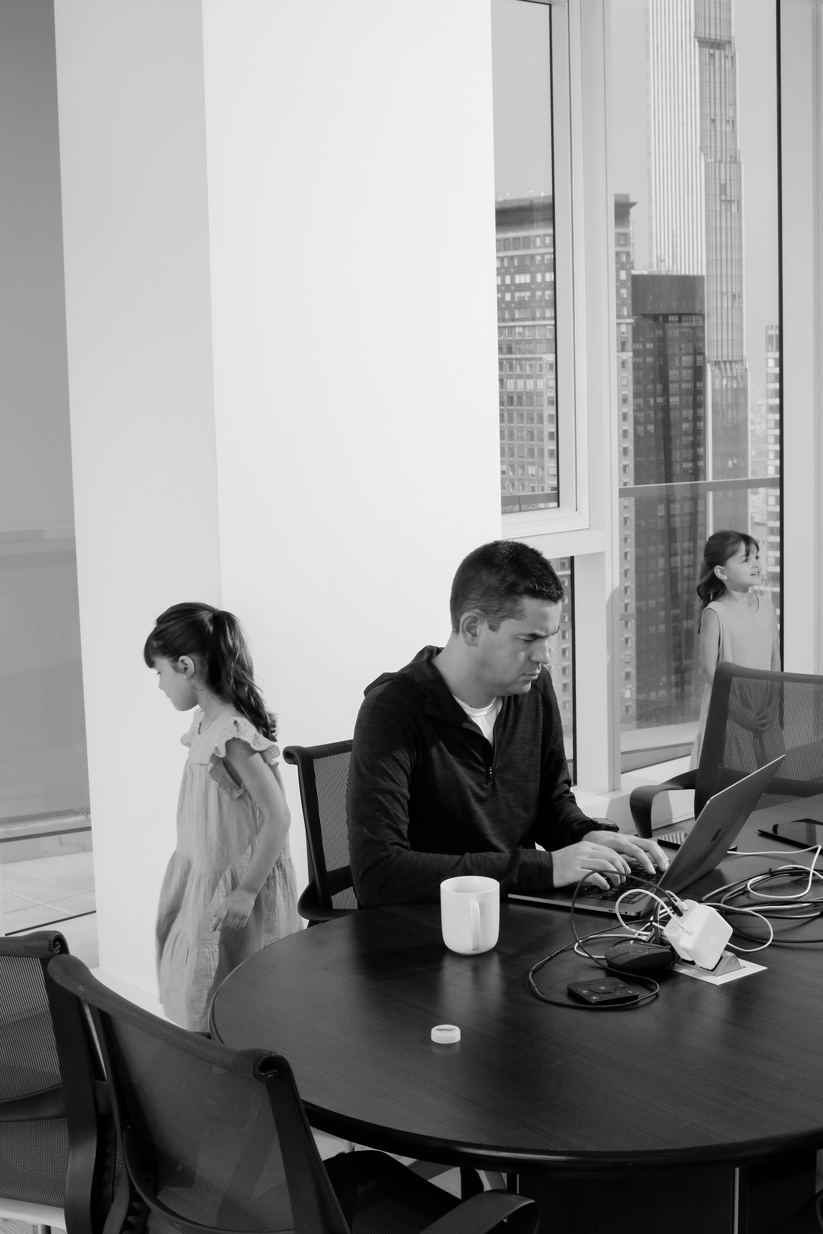Jared Isaacman and his daughters at their apartment in New York City, July 2021.