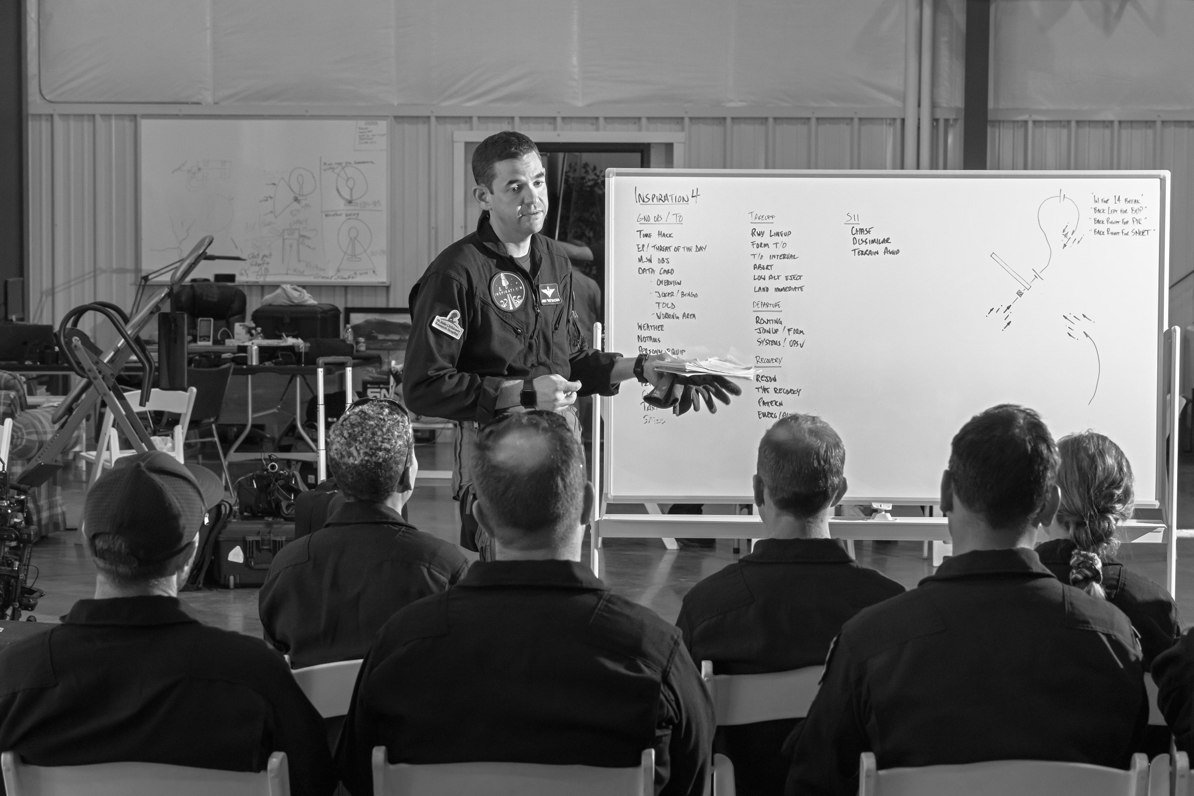 Jared Isaacman briefs the Inspiration4 crew before a training session in Belgrade, Mont., on Aug. 7, 2021.