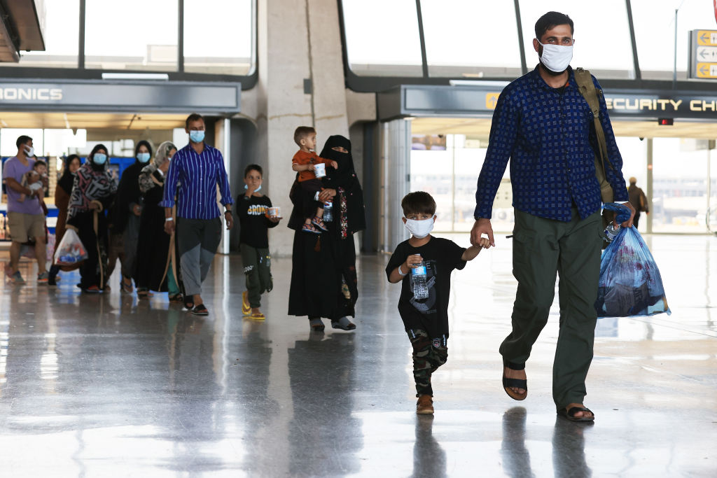 Refugees arrive at Dulles International Airport after being evacuated from Kabul following the Taliban takeover of Afghanistan August 27, 2021 in Dulles, Virginia.