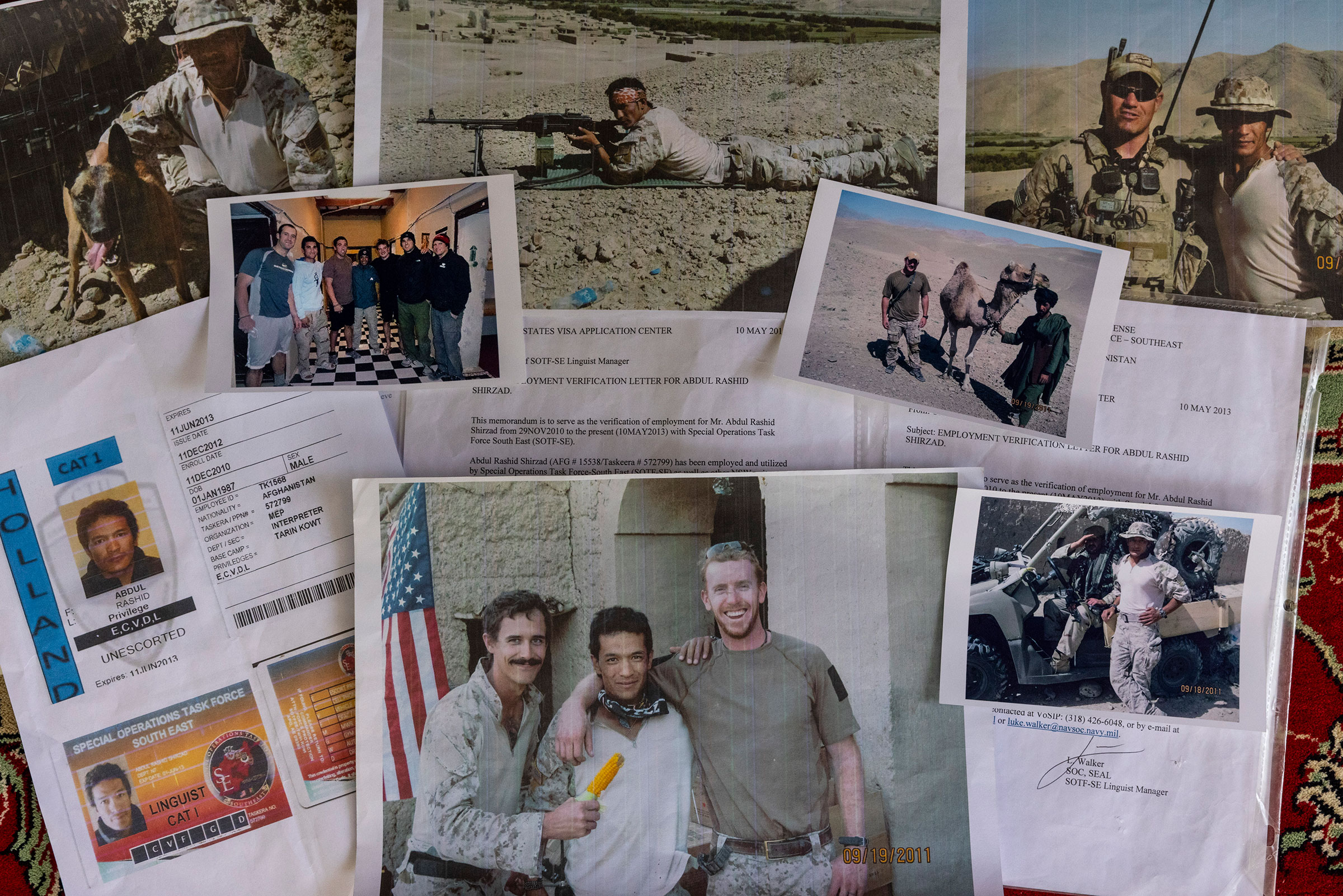 Photos and letters from the military collected by Abdul Rashid Shirzad are seen July 1, 2021 in Kabul, Afghanistan. Shirzad's application for a Special Immigrant Visa to the U.S. was denied without any explanation after years of service to the U.S. military.