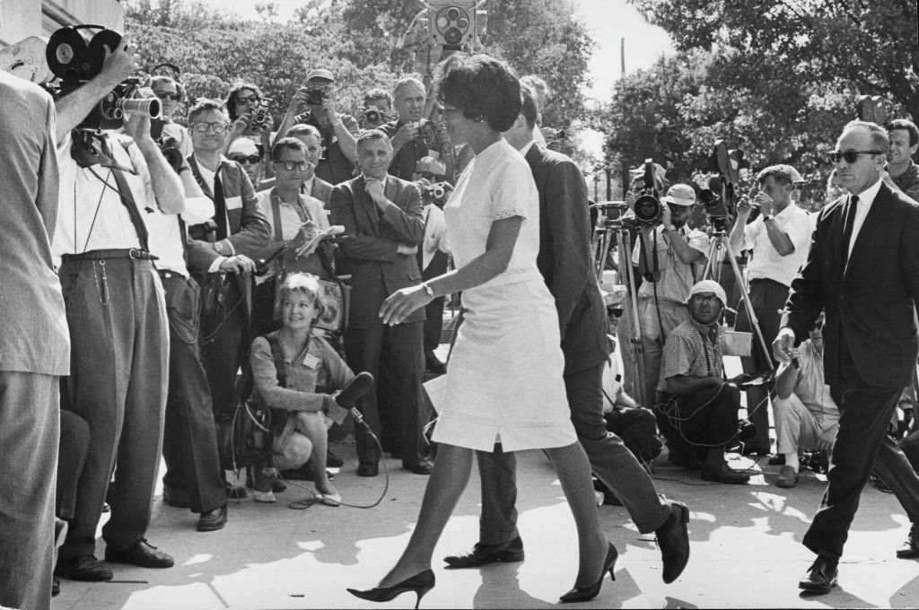 American students Vivian Malone (1942-2005) and James Hood (1942-2013) walk through the crowds as they become the first African American students to enrol at the University of Alabama in Tuscaloosa, Alabama, 11th June 1963.